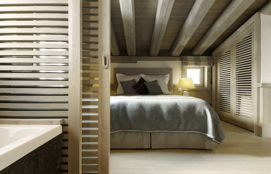 1st bedroom at night dim lights Catered Chalet in Val D'Isere - Black pearl