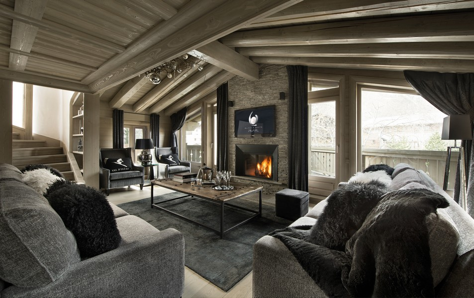 Fire place lit at the Black pearl Chalet val disere
