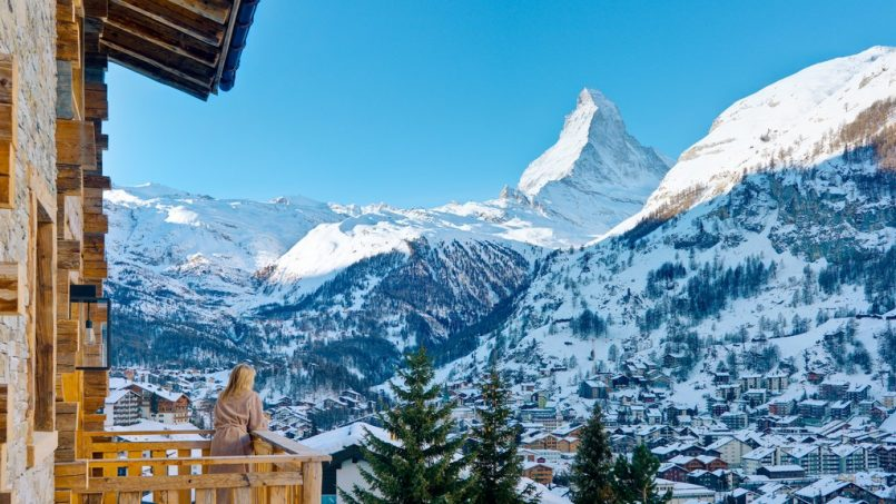 The lady starring form the balcony at the Matterhorn Mountains Les Anges chalet in Zermatt
