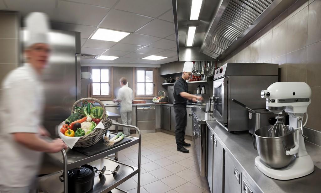 Kitchen at work Chalet Ormello in Courchevel 1850