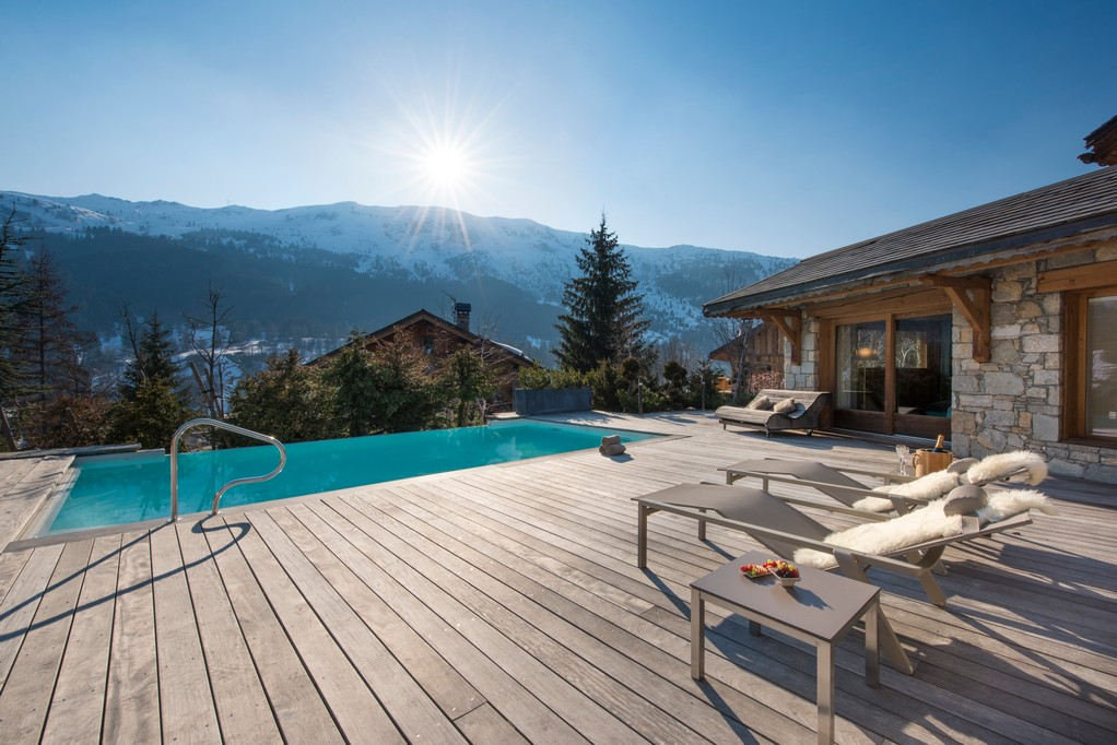 Outdoor pool with mountain views from Mont Tremblant Chalet in Meribel