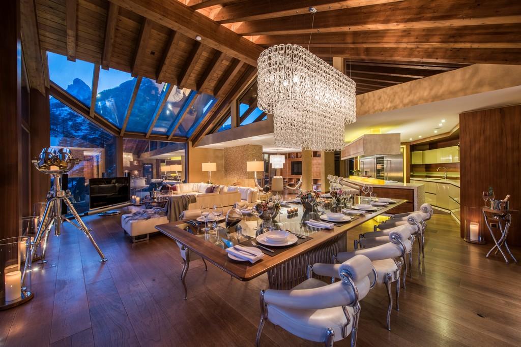 Side dinner table view with outdoors Chalet Zermatt Peak