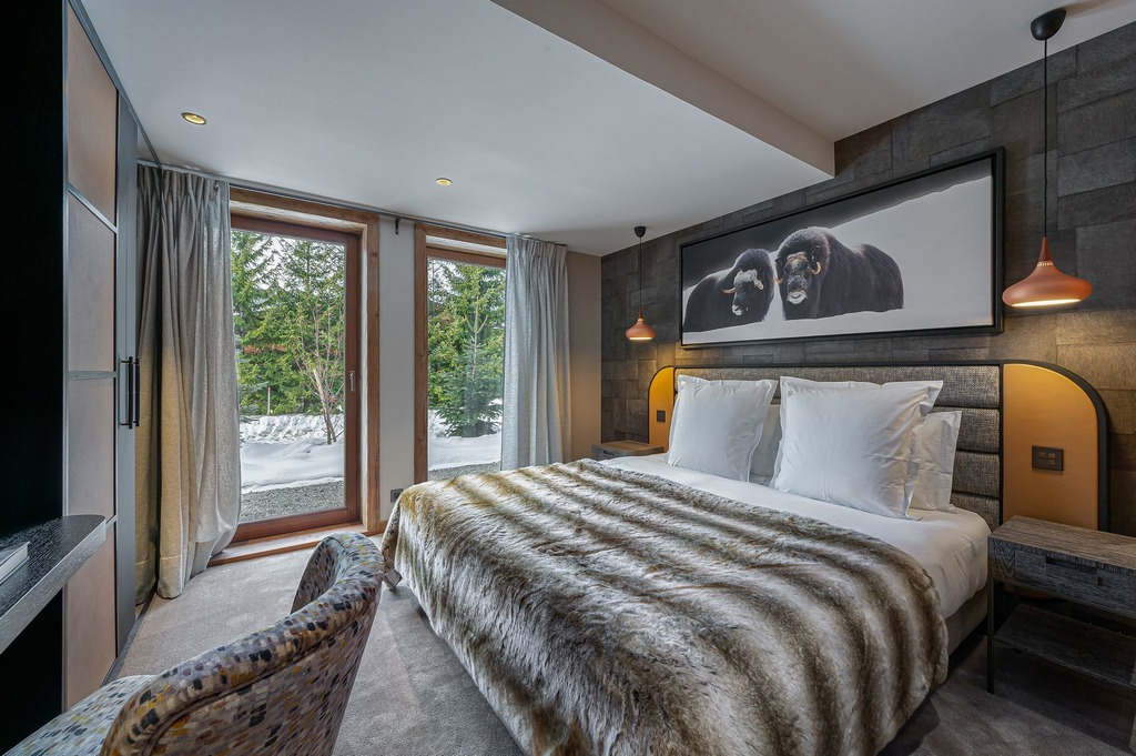 Double ensuite bedroom Sofa area living room Chalet Divinity Megeve